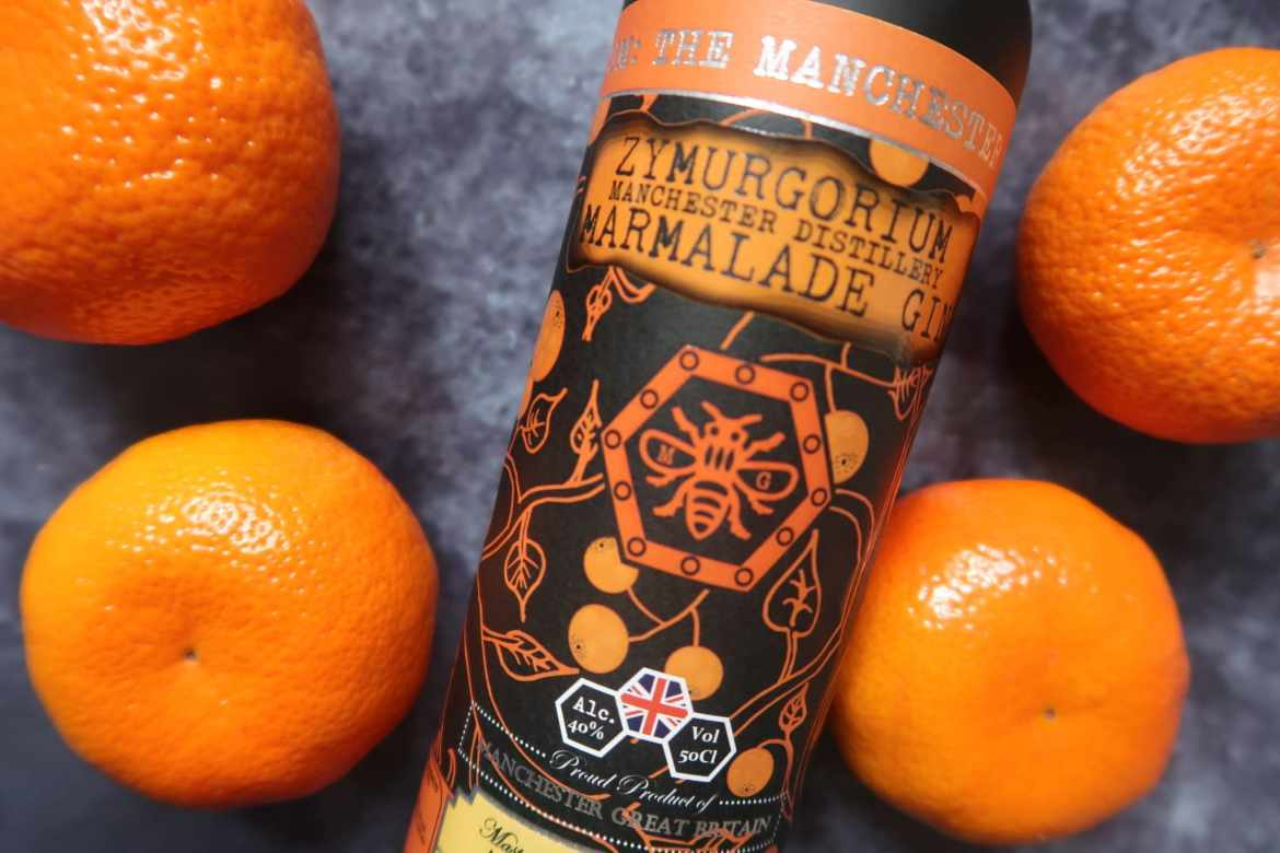 Marmalade gin bottle close up surrownded by oranges