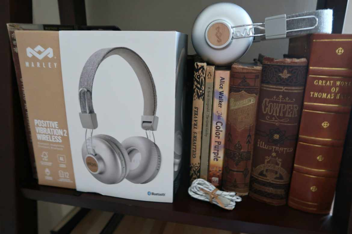 environmentally friendly living house of marley silver headphones on a bookshelf of brown books