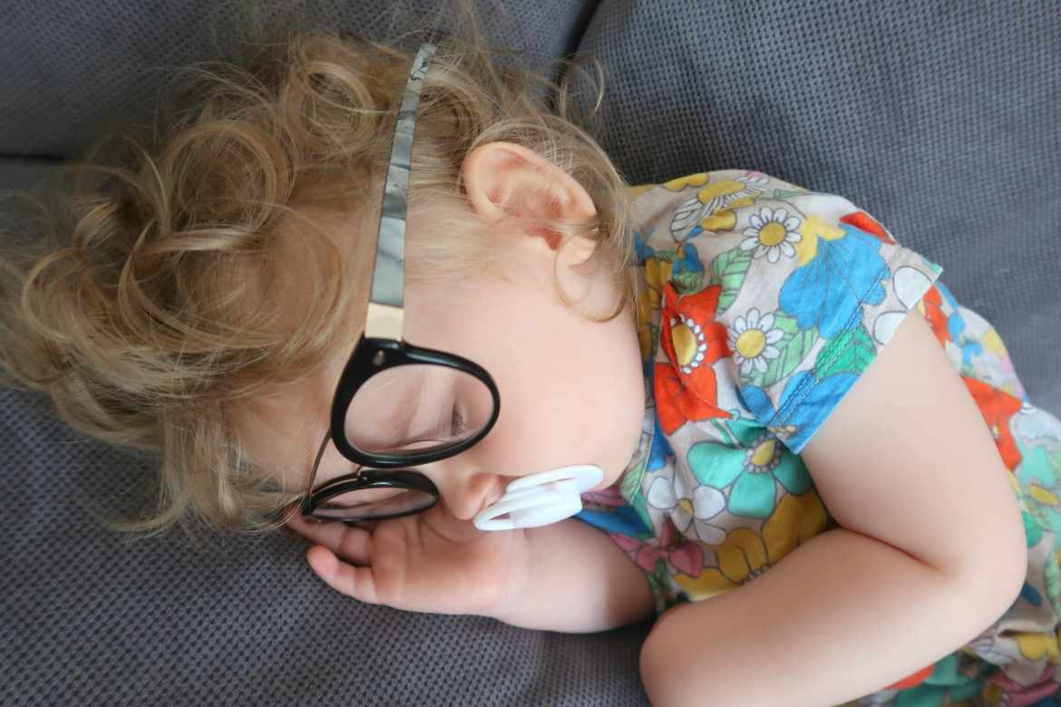 baby wearing iChoose frames whilst sleeping