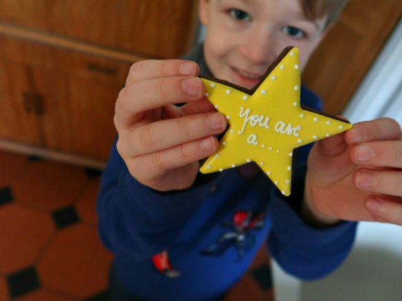 A nboy holding a star biscuit