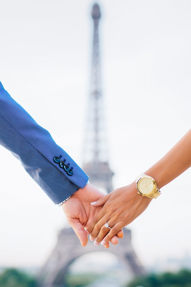 Holding hands and Eiffel Tower