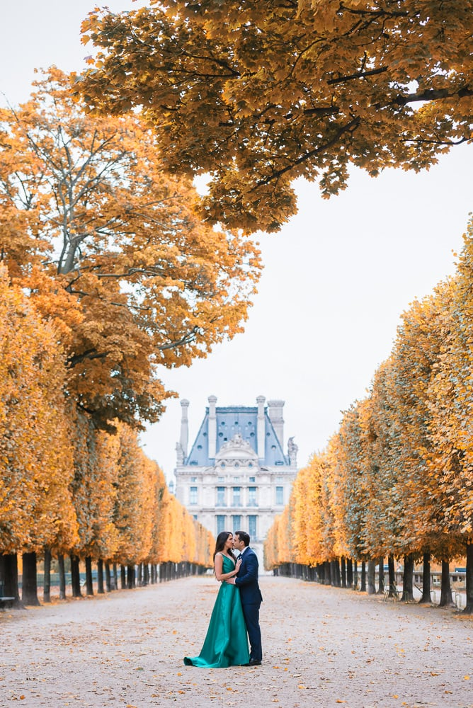 Fall engagement photos in Paris - Newly engaged couple kissing in autumn in the Tuileries gardens in Paris France