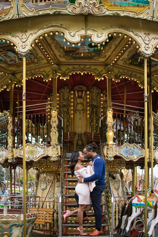 Cute couple photo shoot on the merry go round near the Eiffel Tower in Paris