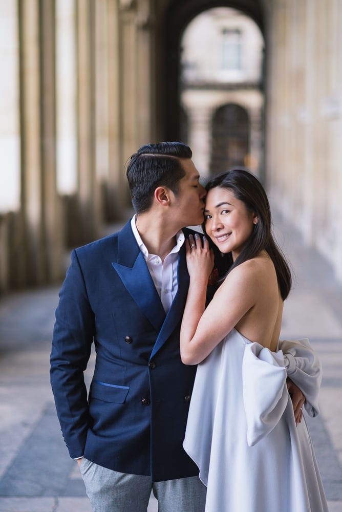 Paris photographer engagement - Beautiful couple with bow tie creator dress gorgeous engagement photos