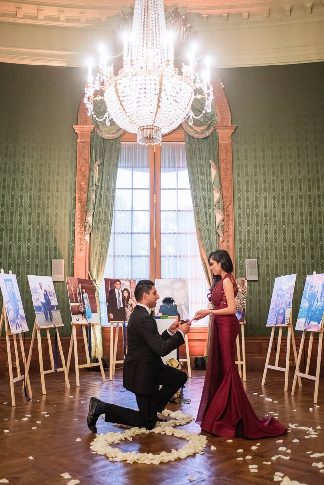 proposal in paris at the Shangri La luxury hotel with flower petals on the floor and beautiful chandelier