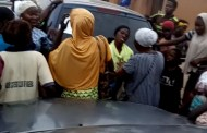 Drama as Woman Falls into Trance inside Market