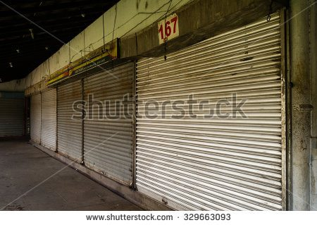 stock-photo-row-of-closed-shops-at-kandy-market-sri-lanka-329663093.jpg