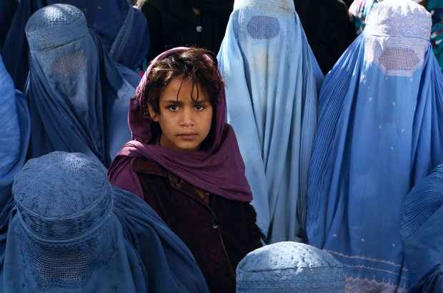 epa03930038 Afghan women wait to receive medical treatment at a local hospital in Kabul, Afghanistan, 30 October 2013. In rural areas of Afghanistan women are not allowed to seek medical help from a male doctor. Afghanistan has the second highest maternal mortality rate in the world where poor health conditions and malnutrition made pregnancy and childbirth exceptionally dangerous for Afghan women. EPA/S. SABAWOON