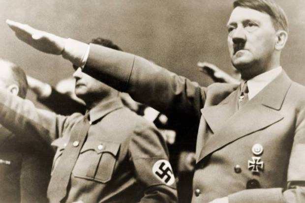 Adolf Hitler, giving Nazi salute. To Hitler's right is Rudolph Hesse. 1939. Everett Collection