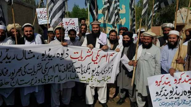 JUI activists carrying out a protest demonstration against Deewah Radio and Mashal Radio where they sought ban on these two radio channels running their programs respectively from Washington DC and Prague