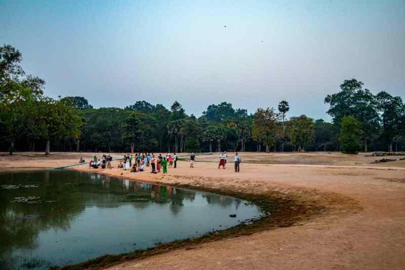 Small crowd at sunrise at Angkor Wat