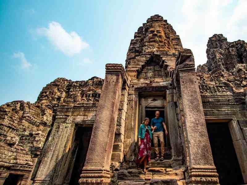 Couple on stairs at Bayon Temple - Angkor Wat