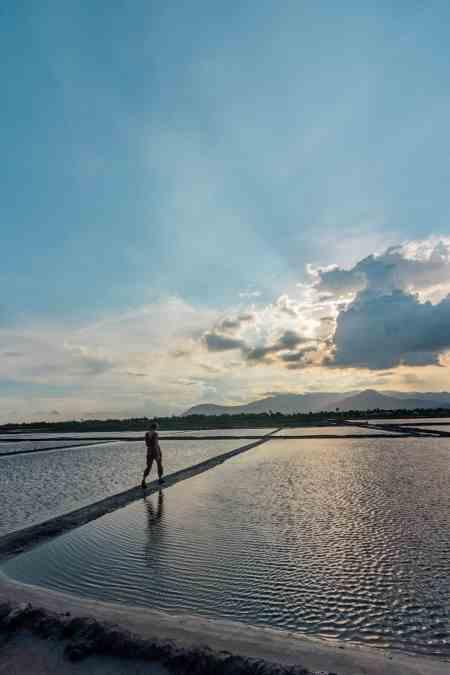 Alicia Walking in Salt Fields in Kampot, Cambodia