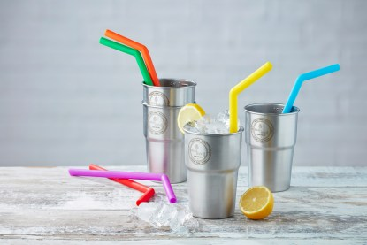 colourful straws in stainless steel cups