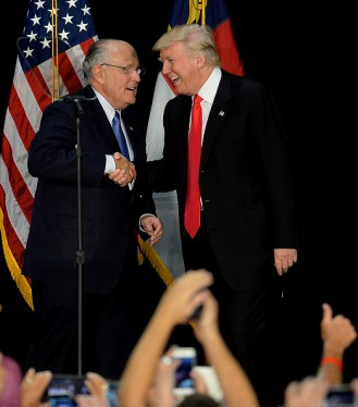 Former New York City mayor Rudy Giuliani, left, welcomes Republican presidential candidate Donald Trump on stage during a campaign rally at the Charlotte Convention Center in Charlotte, N.C., on Thursday, Aug. 18, 2016. (Jeff Siner/Charlotte Observer/TNS via Getty Images)