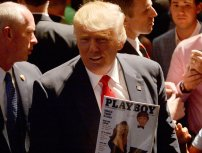 RALEIGH, NC - JULY 5: Presumptive Republican presidential nominee Donald Trump shows a police officer his photo on the cover of a Playboy magazine during a campaign event at the Duke Energy Center for the Performing Arts on July 5, 2016 in Raleigh, North Carolina. Earlier in the day Hillary Clinton campaigned in Charlotte, North Carolina with President Barack Obama. (Photo by Sara D. Davis/Getty Images)
