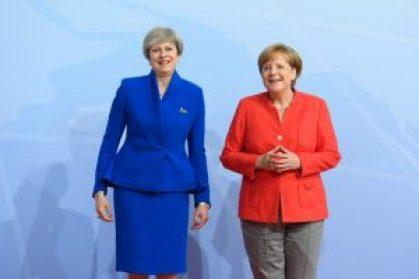 Federal Chancellor Angela Merkel welcomes British Prime Minister Theresa May to the G20 Summit in Hamburg..jpg