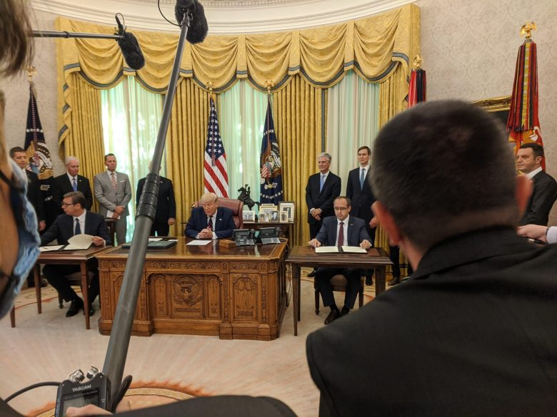 Hoti and Vucic each had a separate folder with a piece of paper in front of them that they each signed. Then Trump signed two pieces of paper in two different folders and handed each one of the leaders one, before they began applauding.