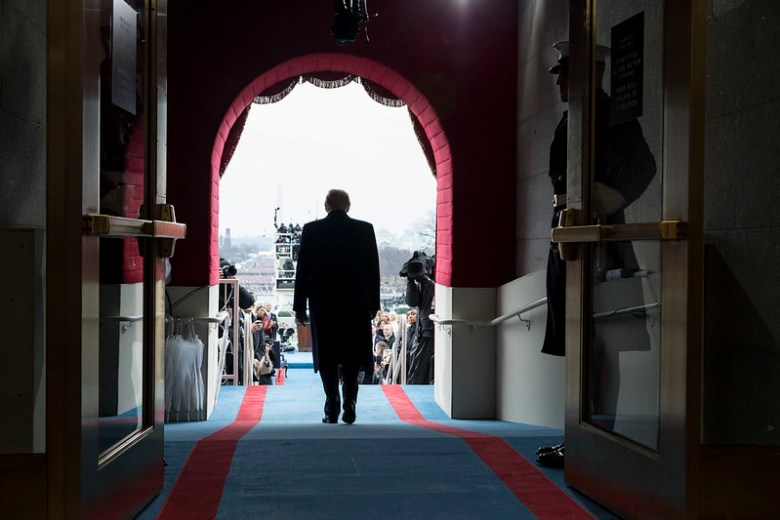 President-elect Donald Trump walks to take his seat for the inaugural swearing-in ceremony at the U.S. Capitol in Washington, D.C., Friday, January 20, 2017. (Photo by Shealah Craighead)