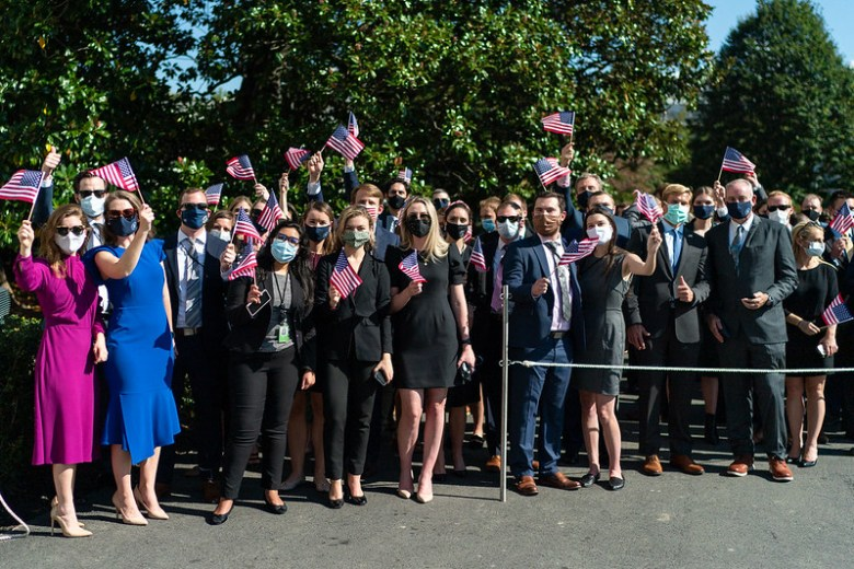 White House staff members wave American flags as Marine One with President Donald J. Trump and First Lady Melania Trump aboard departs the South Lawn of the White House Thursday, Oct. 22, 2020, to begin their trip to Nashville, Tenn. (Photo by Andrea Hanks)