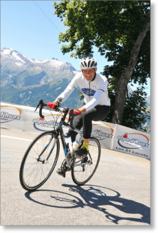 Robert Hess climbing the Alpe d'Huez on his bicycle