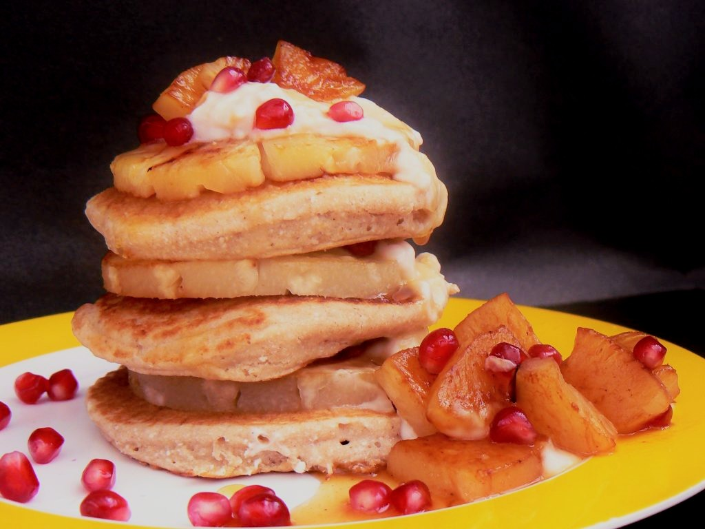 Looking for something a little different this pancake day? Then look no further than these yummy Vegan Coconut & Lime Pancakes. They are really easy to make and just happen to be Free From Dairy, Egg & Gluten as well as suitable for coeliacs and vegans! The pancakes are stacked with grilled pineapple slices, big dollops of vegan coconut yoghurt and drizzled with a sticky ginger syrup.  The whole dishmakes a very lovely lazy brunch for two - if you feellike sharing that is!