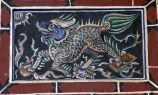 Wall carving of a Chinese dragon causing havoc