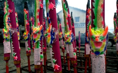 Giant joss sticks with dragon carvings