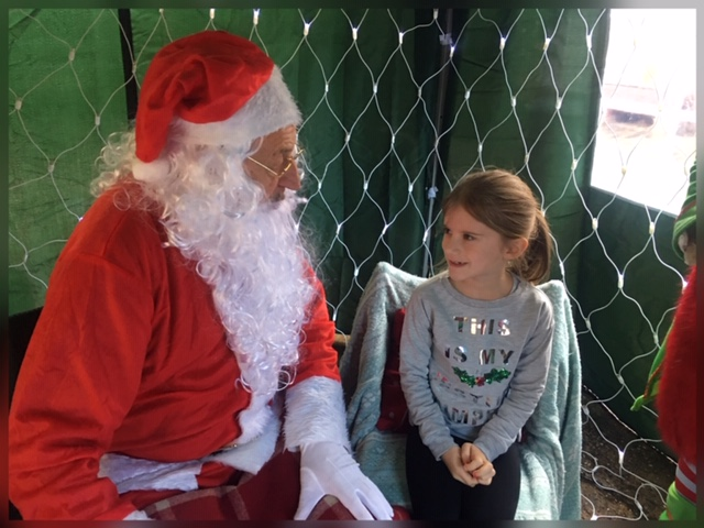 Charlotte visiting father christmas at the chocolate workshop