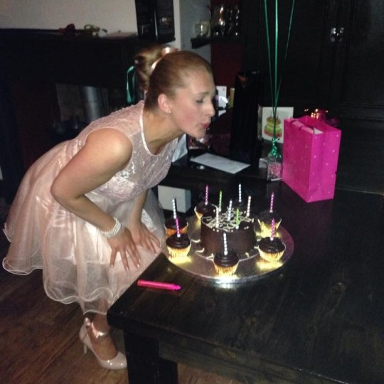 Thirtieth birthday ballerina - Katie is dressed as a ballerina and is blowing out candles on her cake