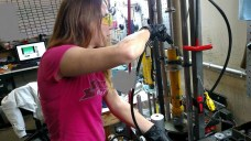 Deana draining the oil from one of her rear dampers