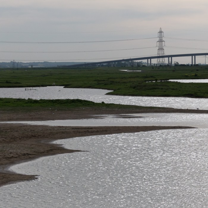 Kingsferry Bridge to the Isle of Sheppey from Chetney Marshes.