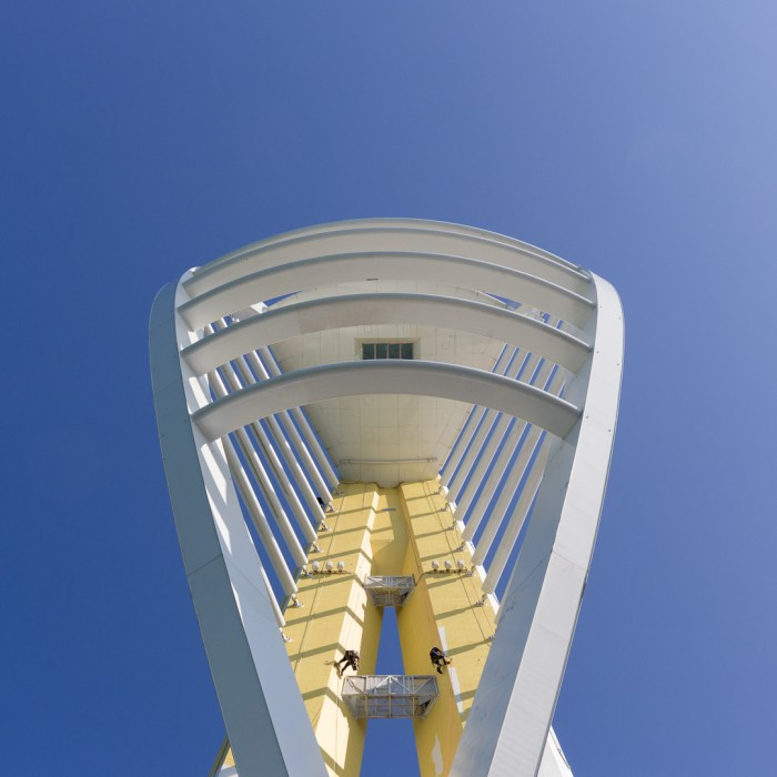 Spinnaker Tower being painted gold for rebranding as Emirates Spinnaker Tower. The 170 meter structure was designed by HGP Architects and built in 2005. Portsmouth, Hampshire.