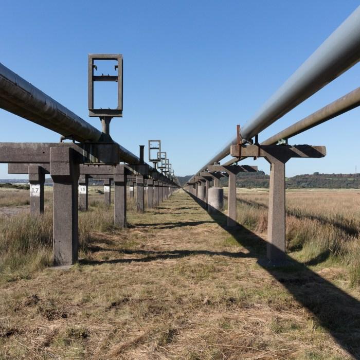 Raised pipe line from former BP Chemicals Works, Baglan Bay, Glamorgan.
