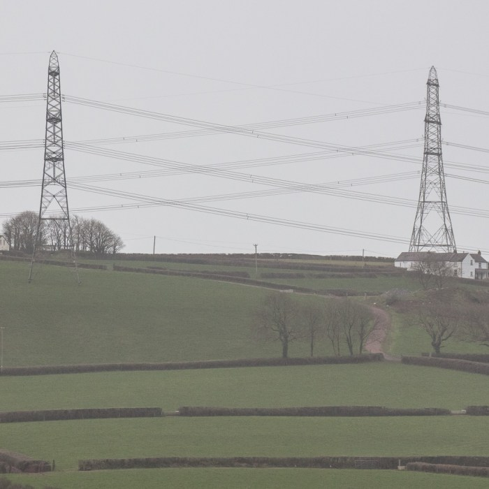 Criss-cross. Pylons on the Angle peninsula, Pembroke, Pembrokeshire.
