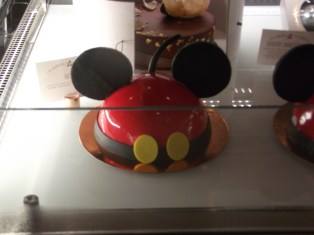 Everything on this cake is edible. The ears are white chocolate that are painted black.