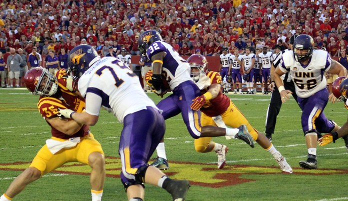 Iowa State junior linebacker and former Perry standout Kane Seeley tackles Northern Iowa's Tyvis Smith during their season opener at Jack Trice Stadium in Ames Saturday.