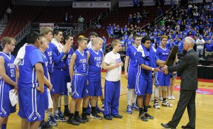 The Perry players receive a State Participation plaque and medals after their quarterfinal loss Mar. 8.