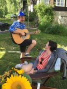 My husband serenading me with a song he wrote for me:)