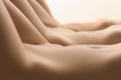 3 nude female abdomens