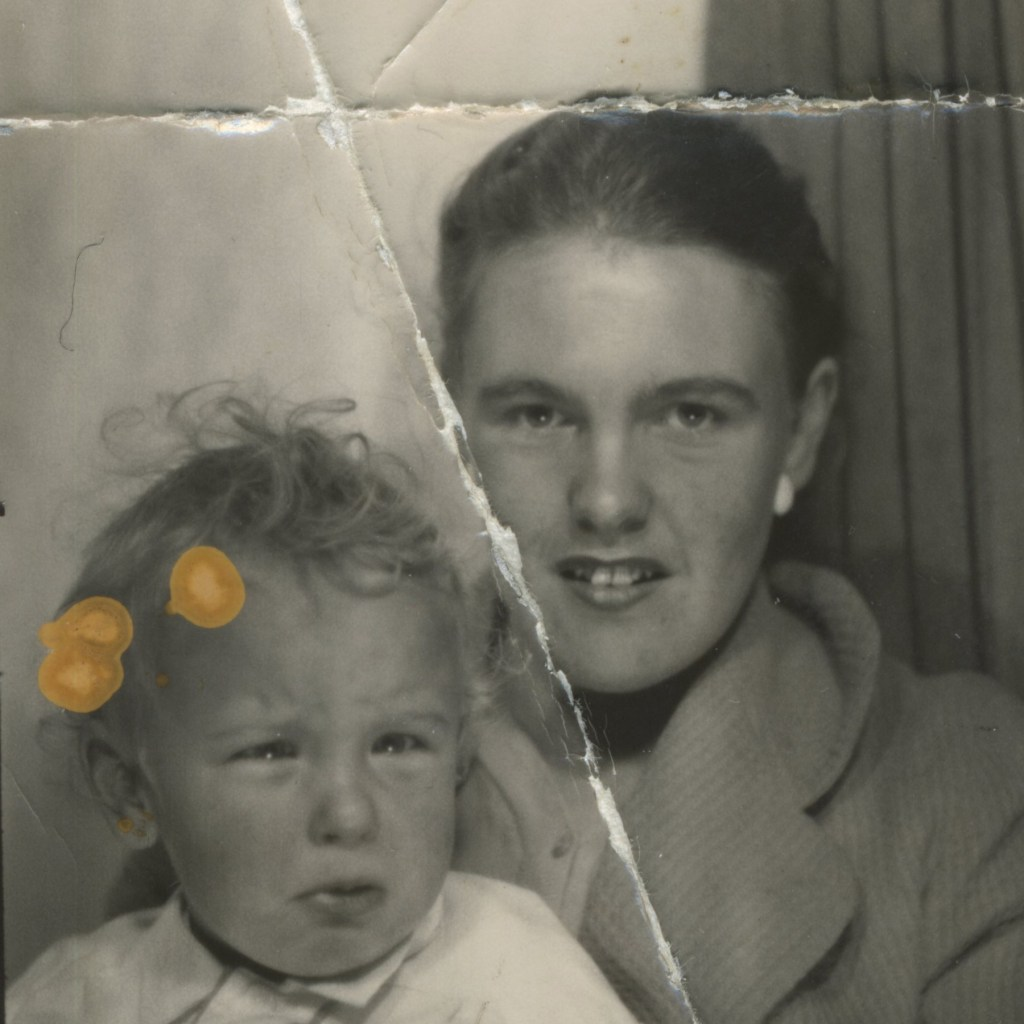 Photo of a lady and a child with cracks through the photo.
