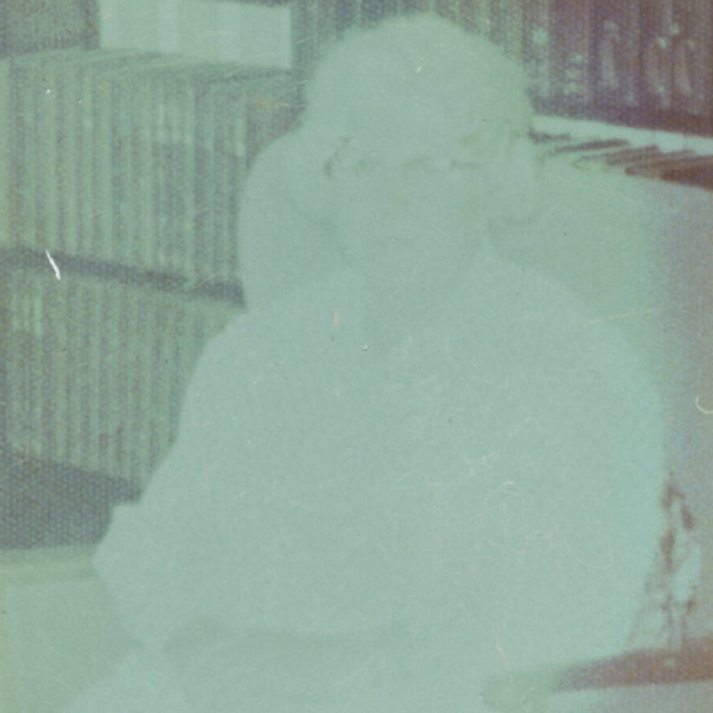 Photo of an old lady which has faded so much you can only see an outline.