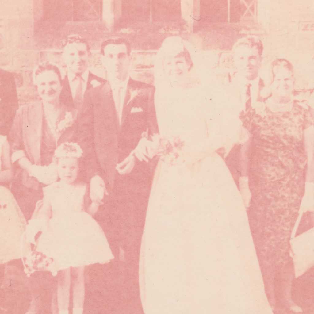A wedding photo which has faded so much that the details can't be made out