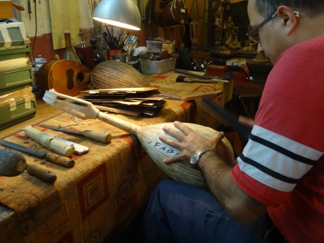 Demonstration of the techniques used to make a mandolin in 'La Bottega del Mandolino' in Naples, Italy