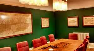 Framed maps hung in a company boardroom in Eastbourne