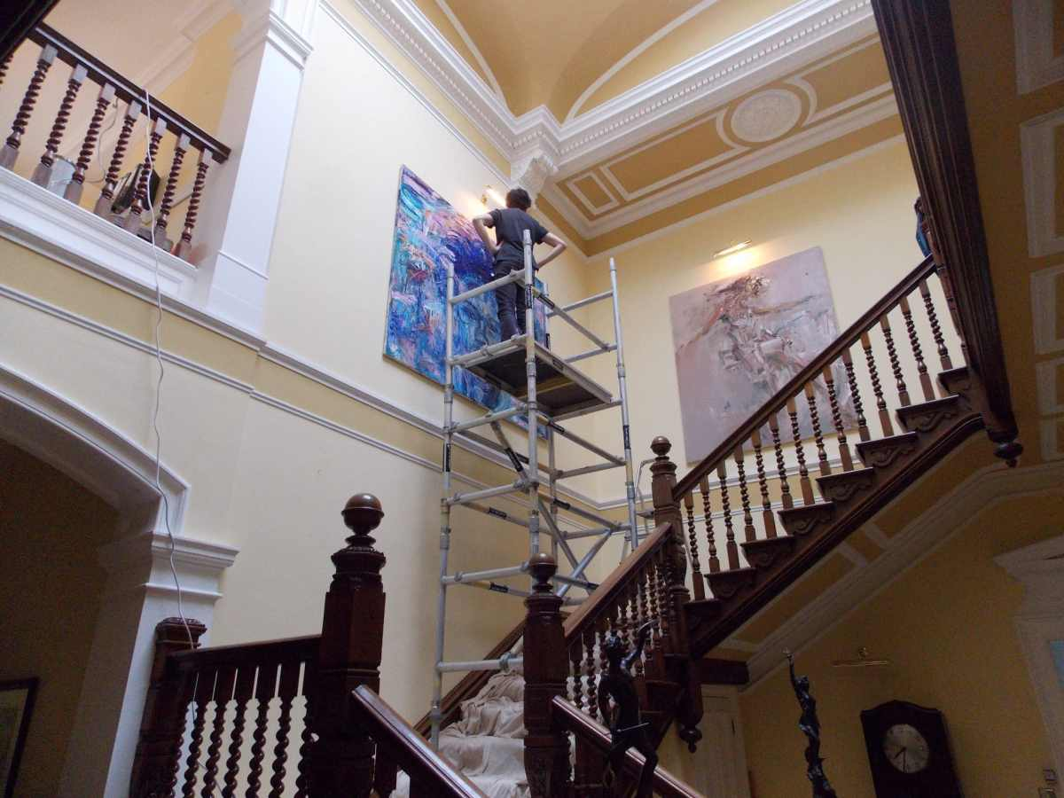 Installing work by George Gittoes in Laughton Manor, East Sussex, 2013