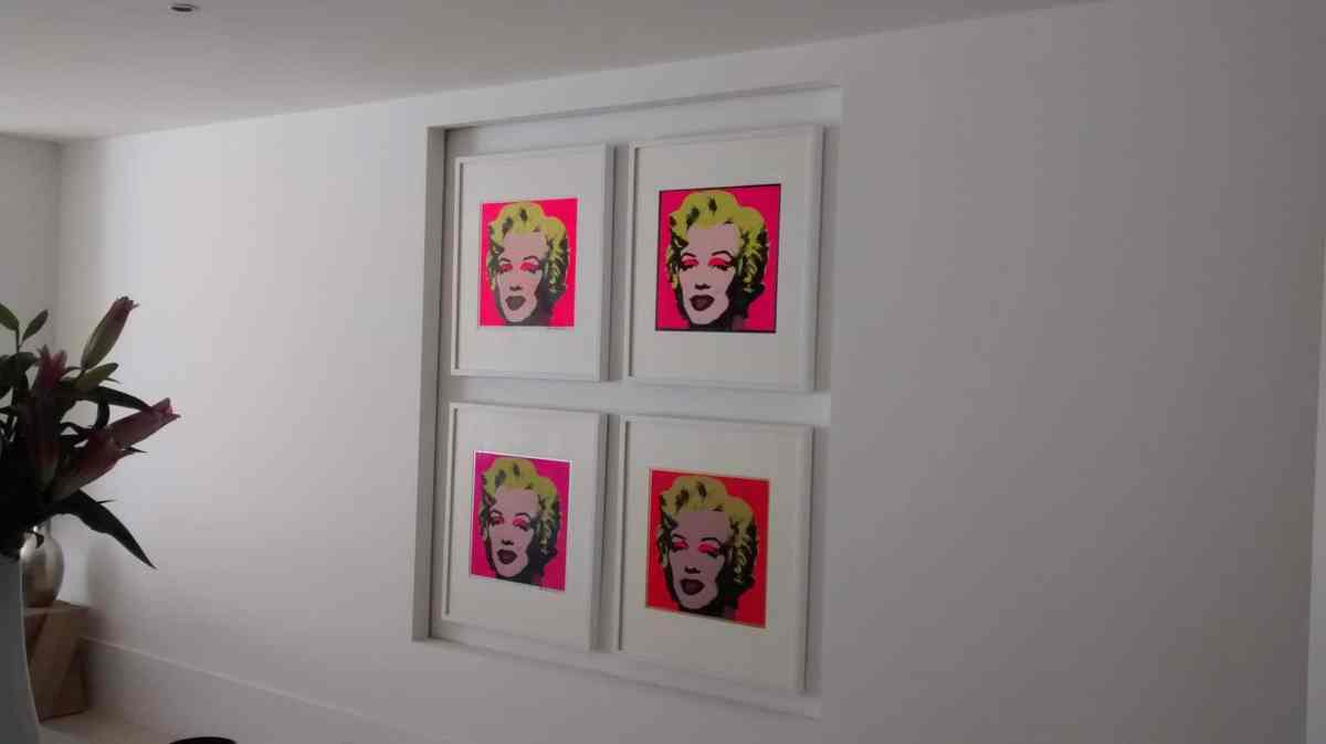 In a home in Haywards Heath four pink Marilyn Monroes, hanging in an alcove.