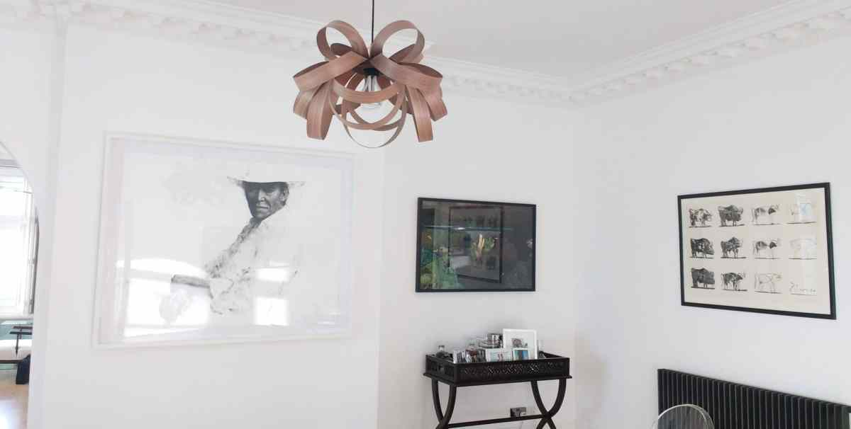 Large pictures command the space in a living room in Hove.