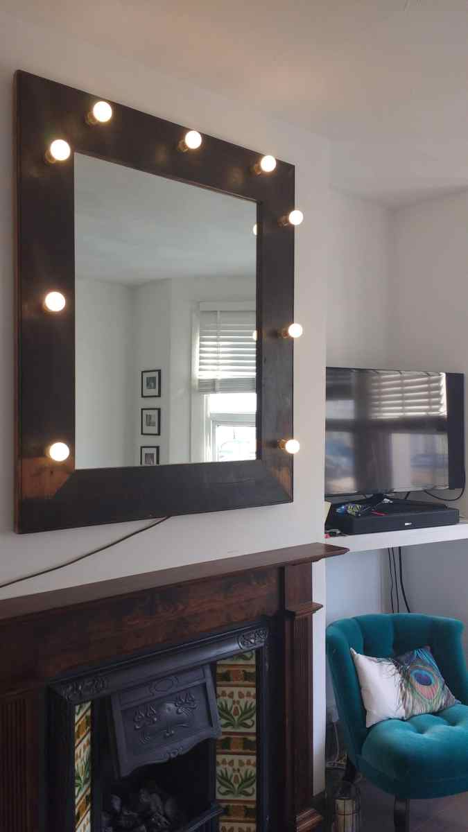 Showtime! Upcycled Hollywood style illuminated mirror hung in a living room in Brighton.