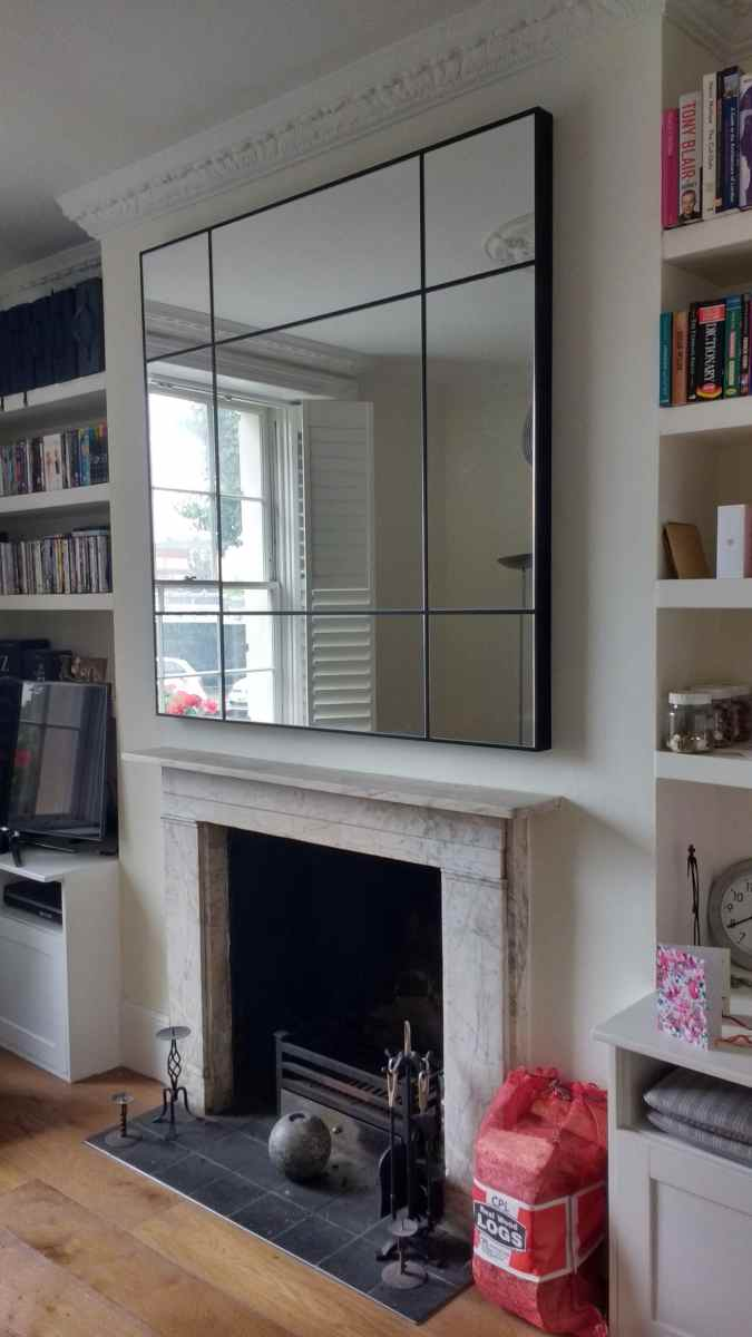 1.4m x 1.4m square mirror from Heal's installed above a fireplace.